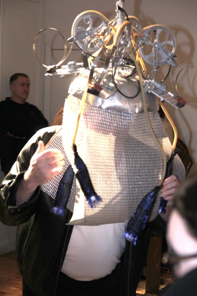 Untitled Head Piece, 2012, Renee Lantz, cricket microcontroller, pulleys, worm gear, motors, fiberoptic lights, speaker cloth, salad bowl, IR detectors. photo credit Ellen Wetmore. (Used with permission.)