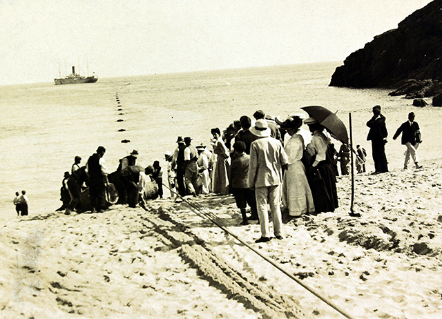 Fig. 1. The cableship Colonia lands a cable at Porthcurno in the United Kingdom, 1906, Photographer Unknown, Photograph, © Cable & Wireless Communications 2013. (By permission of Porthcurno Telegraph Museum.)