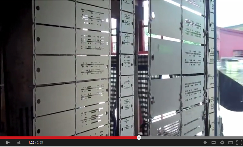 Example of a punch card loom, YouTube screen capture, https://www.youtube.com/watch?v=lwozgRPLVC8, accessed June 28, 2014.