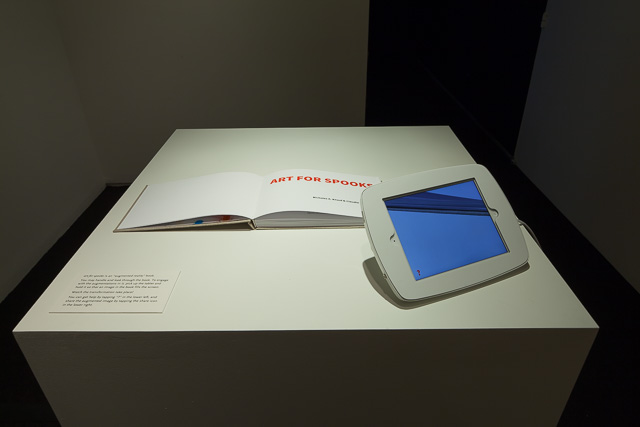Art for Spooks, 2014, Nicholas A. Knouf and Claudia C. Pederson, hand bound case-bound book, iPad, found images and text, custom software. CC BY-SA 2.0.