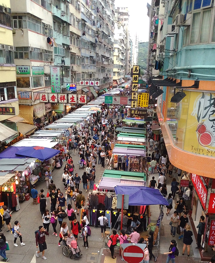 Hong Kong apartment blocks and street market, 2015. ©Jane Prophet