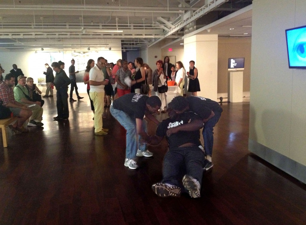 "Lexie Mountain ""BALL HARD"" Performance still Dennis Williams, Joseph Mitchell and William Hubbard performing at the opening of Cyber InSecurities, Pepco Edison Place Gallery, Washington Project for the Art's Experimental Media. August 30, 2013. Image courtesy of Tim Nohe."