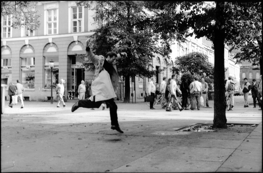"David Rokeby ""Very Nervous System"" 1983 - 1991 (original VNS system). Interactive audio installation, custom software, camera, sound system, dimensions variable. Image of the artist performing VNS in the streets of Potsdam, Germany for the Potsdam 1000th anniversary, 1993. Photograph by Lambert Blum, image courtesy of the artist."